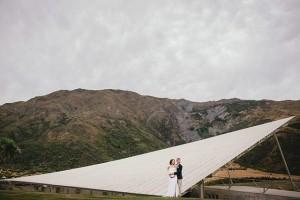Image of newlyweds getting their wedding photos taken