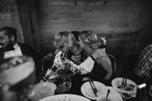 Black and white image of bridesmaids at wedding table
