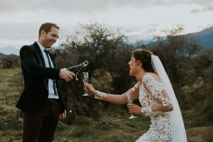 Image of couple pouring champagne on their wedding day
