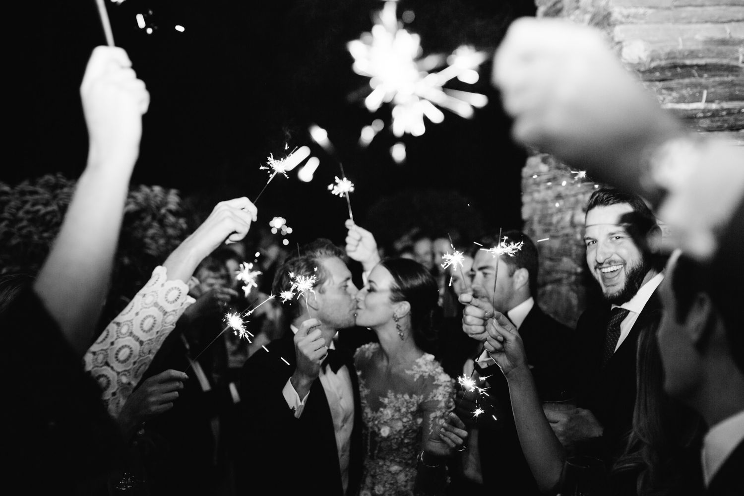 Image of couple leaving their wedding reception under sparklers