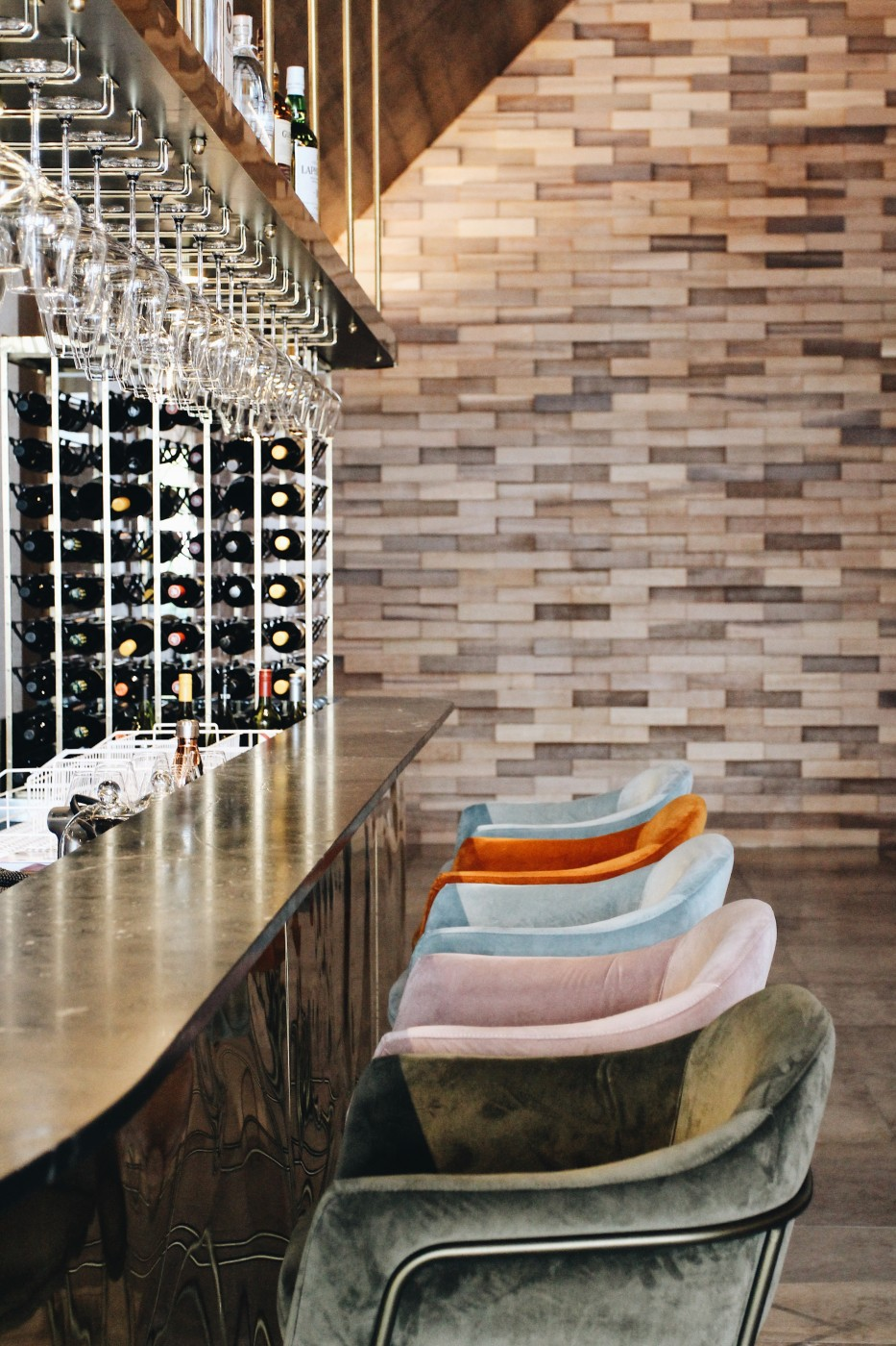 Image of multi coloured bar stools along the bar at Kāmana Lakehouse.
